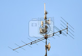 Photo television antenna and wifi transmitter on the roof against blue sky