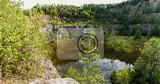 beautiful landscape of abandoned and flooded quarry with shallow water and water plants czech republic