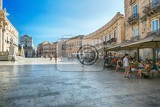 syracuse italy  jul 26 2016 tourists and locals visit the main square and a local restaurant at the piazza del duomo in ortigia syracuse italy ortigia is a small island which is the historical center of syracuse sicily