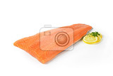 fresh salmon fillet and lemon on white background