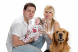 Fotografie happy young family with newborn and dog on a white background