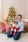father with her daughter at christmas tree