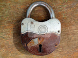 Fotografie old rusty padlock on wooden background