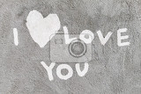 Fotografia inscription i love you with abstract heart on the concrete wall