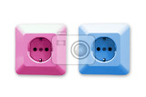 pink and blue electric sockets on white background