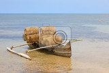 Photo typical malagasy bamboo woven crustacean fishing trap and catamaran on beach in nosy be madagascar rural scene