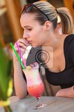 Fotografie attractive girl drinking tropical drink cocktail
