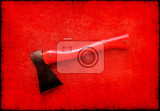 red axe on red board background