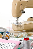 sewing machine cotton cotton fabric and tailor measurement tape with spools of thread cotton isolated on white