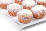 Fotografie fresh homemade muffin on plate isolated on white background
