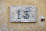 Photo house number on a weathered wall