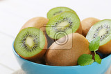 bowl of whole and halved kiwi fruits