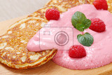 Fotografie american pancakes with pink yogurt and fresh raspberries on wooden cutting board  close up