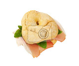 Fotografie ringshaped bread roll friselle with slices of schwarzwald ham