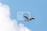 Photo small sightseeing aircraft in blue sky with white clouds