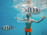 Fotografie young boy snorkel swim in underwater exotic tropics paradise with fish marsa alam egypt summer holiday vacation concept