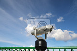 coinoperated spy viewing machine against cloudy sky
