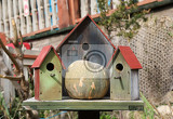 Fotografia three wooden bird houses and pumpkin in popeye village sweethaven malta
