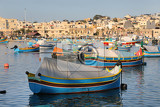 traditional colorful fishing boats luzzu moored at marsaxlokk marsascala harbor malta