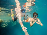 Fotografie father and son  snorkel in underwater exotic tropics paradise with fish and coral reef beautiful view of tropical sea marsa alam egypt summer holiday vacation concept