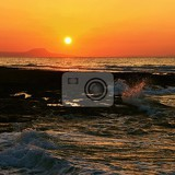 beautiful summer sunset by the sea amazing scenery on the beach with waves and reflection of the sun background for holiday and vacation travel greece crete island