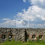 the walls of the castle with a background of blue sky and clouds