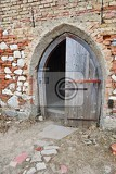 Fotografie old open the church door with a brick wall