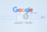 Fotografie the largest internet search engine blurred background with the word google