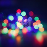 Fényképek christmas blurred lights on black background with copy space abstract colorful reflections of bulbs on a christmas tree
