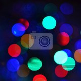 Photo color abstract blurred backgrounds  bokeh christmas lights on a pure black background preparing for the holidays