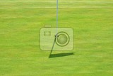 Fotografie nice golf course on a sunny summer day hole with a flag sport