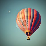 colorful hot air balloon is flying at sunset natural colorful background with sky