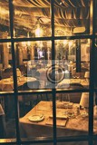 Fotografie feb 17 2017  romantic view over glass of the interior of a small restaurant in the heart of venice italy 17 2017