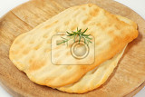 crackerlike italian flat bread made with white flour that is rolled into very thin sheets