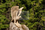big wooden eagle statue bird of prey in forest