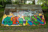 grunge background with graffiti elements on brick wall from unknown author