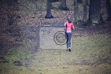 running woman in nature in forest