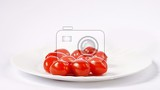 Photo cherry tomatoes stack isolated on white background