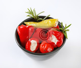 bowl of small pickled red peppers stuffed with cream cheese