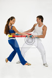 young woman and man with the training device on isolated background