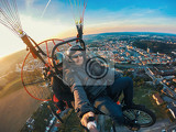 powered paragliding tandem flight man taking selfie with action camera