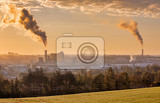 Fotografia sunrise of industrial cityscape with with smoking factory ecology and pollution concept