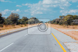 Fotografie endless road in namibia caprivi strip game park with blue sky
