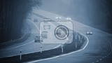bad weather driving  foggy hazy country road motorway  road traffic winter time