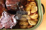 roasted pork knuckle with potatoes as food background