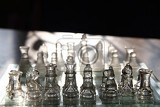 Fotografie glass chess set in the sun light