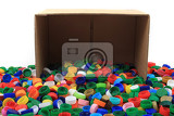 Fényképek color plastic caps in paper box isolated on the white background