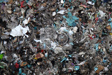 Photo recycled garbage small pieces as technological  texture
