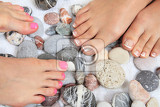Photo womens legs nails and stones pedicure isolated on the white background