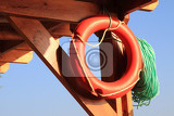 life buoy from the beach as nice summer background